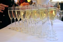 Glasses of champagne on festive table royalty free stock image