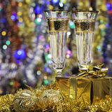 Glasses with champagne and a gift Stock Photo