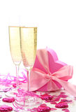 Glasses of champagne and gift box Stock Photos