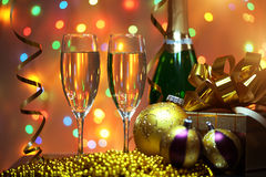 Glasses of champagne with gift box Stock Images