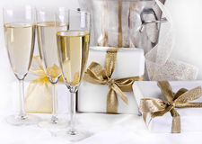 Glasses of champagne and gifts Royalty Free Stock Photos