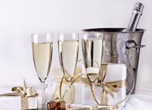 Glasses of champagne and gifts Stock Images
