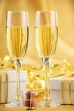 Glasses of champagne with gifts Royalty Free Stock Photos