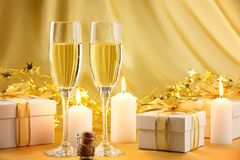 Glasses of champagne with gifts Stock Photo