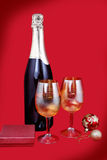 Glasses with champagne and gifts Royalty Free Stock Images