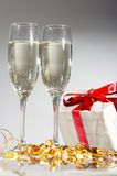 Glasses of champagne , gifts Royalty Free Stock Images