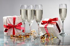 Glasses of champagne , gifts Royalty Free Stock Image