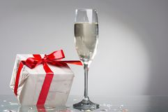 Glasses of champagne , gifts Stock Images