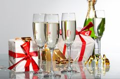 Glasses of champagne , gifts Royalty Free Stock Photos