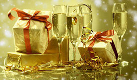 Glasses of champagne , gifts Stock Photos