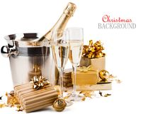 Glasses of champagne. With gifts and balls on white background Stock Photo