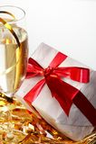 Glasses of champagne, gifts with red tapes Royalty Free Stock Photo
