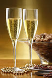 Glasses of champagne with gold background Stock Photo