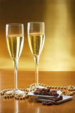 Glasses of champagne with gold background Royalty Free Stock Photo
