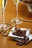 Glasses of champagne with gold background walnuts Royalty Free Stock Photos