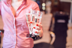 Glasses with champagne for the guests Stock Image
