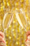 Glasses of champagne in hands Stock Photo