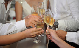 Glasses of champagne in the hands of guests at a wedding.  royalty free stock photography