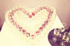 Glasses of champagne in heart shaped setting Royalty Free Stock Images