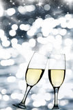 Glasses with champagne and holiday lights Royalty Free Stock Image