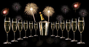 Glasses of champagne with ice bucket and fireworks Stock Images