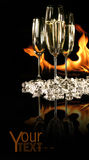 Glasses of champagne with ice and fire stock photo