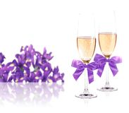 Glasses of champagne and irises Royalty Free Stock Images
