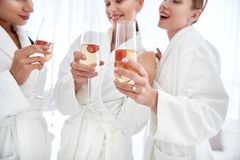 Glasses of champagne in ladies hands drink stock photo