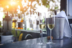 Glasses of champagne in outdoor resort bar Royalty Free Stock Images