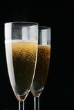 Glasses of champagne over black Stock Photos