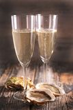 Glasses of champagne and oyster Royalty Free Stock Images