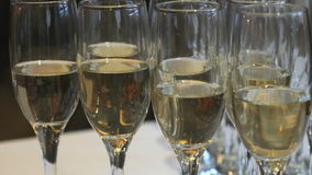 Glasses with champagne on party table. Close-up stock video