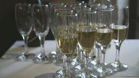 Glasses with champagne on party table. Close-up stock video footage