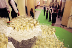 Glasses of champagne piled on the table on an event royalty free stock images