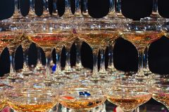 Glasses of champagne. Pyramid of wineglasses. stock photography