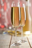 Glasses of champagne on red background Royalty Free Stock Images