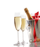 Glasses of champagne with red ribbon gift Stock Images