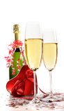 Glasses of champagne with red ribbon heart Royalty Free Stock Images