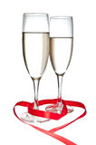 Glasses with Champagne and red ribbon isolated Stock Images