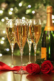 Glasses of Champagne with red roses Stock Images