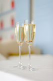 Glasses with Champagne and Rings Royalty Free Stock Images