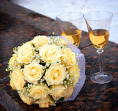 Glasses of champagne and rose bouquet Royalty Free Stock Images