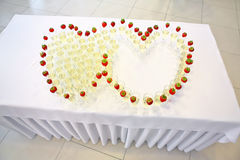 Glasses of champagne in the shape of hearts on wedding celebrati Royalty Free Stock Photos
