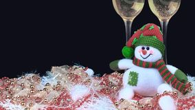 Glasses of champagne with snowmen, decorated, black background stock photos