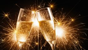 Glasses of champagne with sparklers Royalty Free Stock Photography