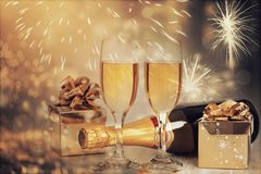 Glasses of champagne on sparkling holiday background with fireworks. On the sky stock photo