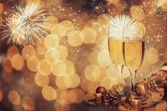 Glasses of champagne on sparkling holiday background with fireworks. On the sky royalty free stock photo
