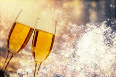 Glasses of champagne on sparkling holiday background with fireworks. On the sky royalty free stock images