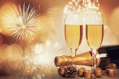 Glasses of champagne on sparkling holiday background with fireworks. On the sky royalty free stock image