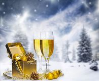 Glasses of champagne on sparkling holiday background with fireworks. Glasses of champagne on sparkling winter background stock images